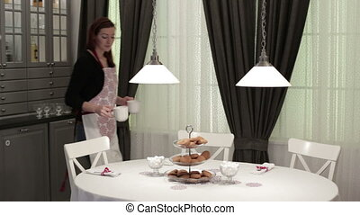 The waitress brings a cup of coffee - Caucasian woman in...