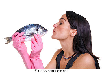 Woman kissing a fish - Woman in pink rubber gloves about to...