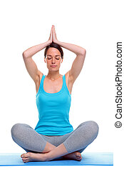 Woman in a yoga meditation pose - Woman sat in a yoga...
