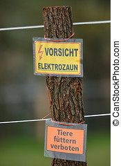 Warning labels on an electric fence