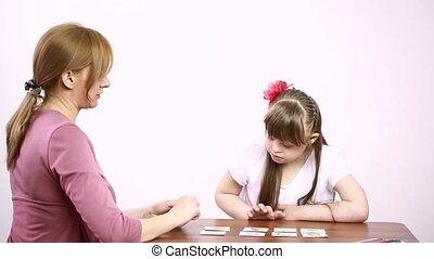 Downs Syndrome girl having speech therapy learning disabled...