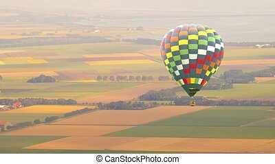 Hot air balloon flying over Dutch landscape