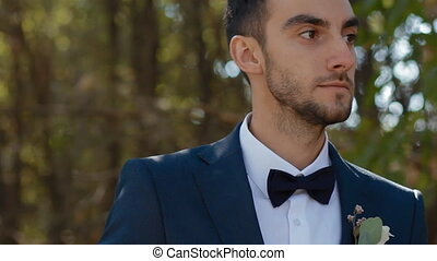 Portrait of the groom - Young man posing outdoor Portrait of...