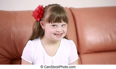 Emotions of a little girl with Down syndrome. disabled girl...
