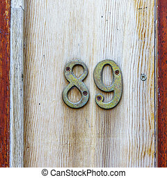 Number 89 - bronze house number eighty nine on a wooden...