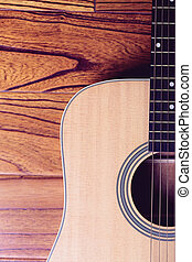 Acoustic Guitar on Wood Background - Closeup shot of...
