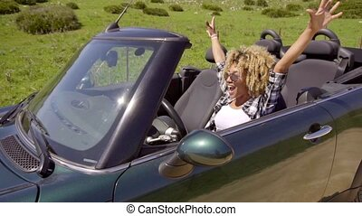 Lady Driving The Car - Young exotic lady with sunglasses at...