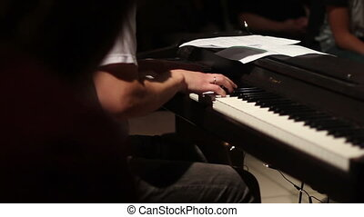 keyboard player playing on electric piano - musical band...