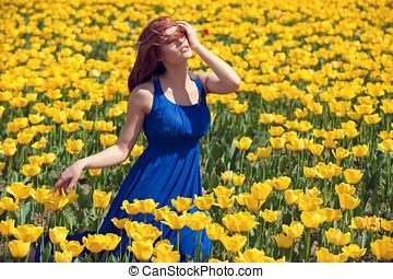 Woman in tulips fiels in outside sunny day - Woman in tulips...