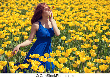 Woman in tulips fiels in outside sunny day - Woman in tulips...