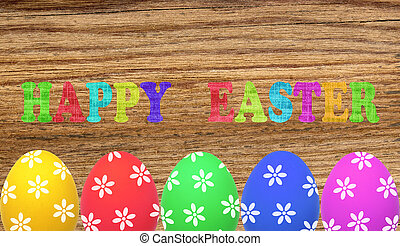 Colorful painted easter eggs on wooden table