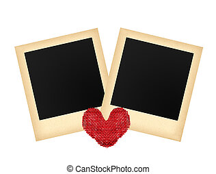 Two old photo papers card and textile red heart isolated on...