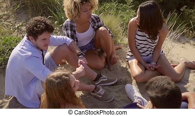 Group Of Young People - Group of five young people sitting...