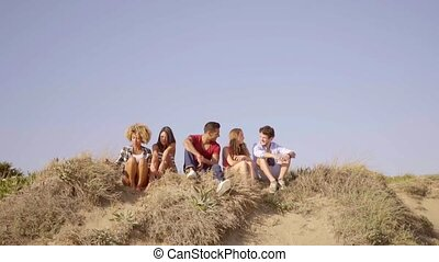 Group Of Young People - Wide shot of group of five young...
