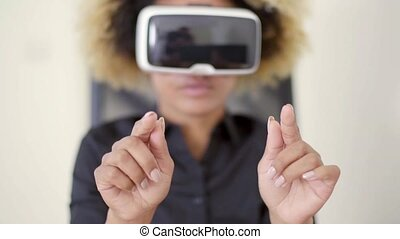 Working In Virtual Reality - A woman working in virtual...