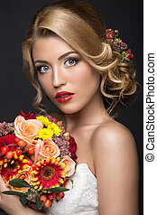 Beautiful blond woman in image of the bride with flowers....