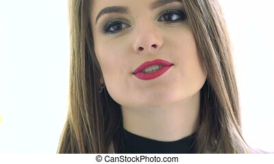 Close up of face sexy brunette with seductive red lips Slow...
