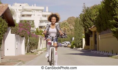 Young Woman Riding The Bicycle - Young exotic...