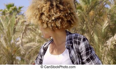 Close up of young woman turned away from camera