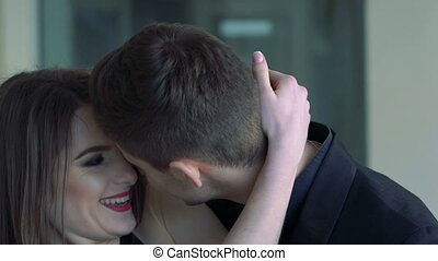 Portrait of a passionate couple in love kissing and...