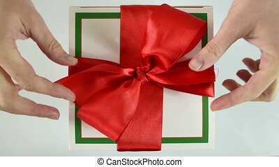 woman hands opening gift box - christmas, x-mas, happiness,...