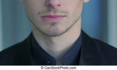 Close up of man's face, neck, lips and shirt. Slow motion...