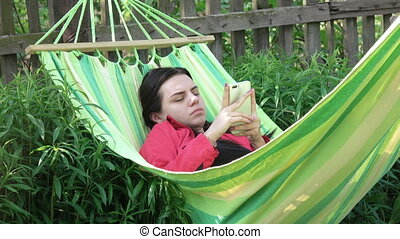 Girl fall asleep in hammock - Nature in hammock and smiling...