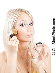 woman putting make up over white - young woman putting make...
