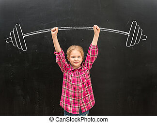 lovely little girl rising up drawm barbell with two hands