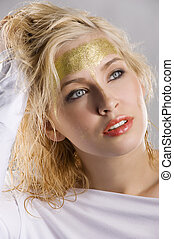 woman with gold make up