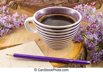 Cup of coffee and spring flowers - Cup of coffee and purple...