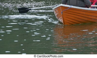 Slipping Boat on Water - A orange boat is slipping on the...