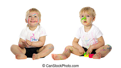 Twins playing with paint