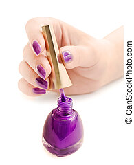 manicure: nail polish and woman hand over white background