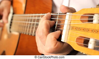 Hand of man playing guitar Musical instrument with guitarist...