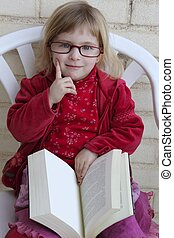 student little girl reading bood