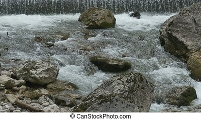 Tumultuous River with Rocks - Close up shot of tumultuous...