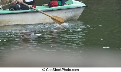 Easy Paddling on Lake - A wood boat with passengers is easy...