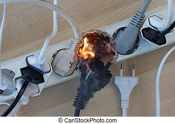 Electrical fire - Fire in overloaded power strip. European...