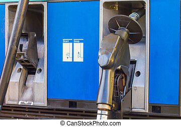 oil - Fuel nozzle at gas station