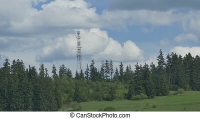GSM Antenna on Mountain - Timelapse with passwing clouds...