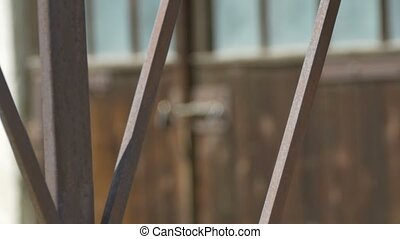 Locked Barn Door - Switching focus on a rusty bars and barn...
