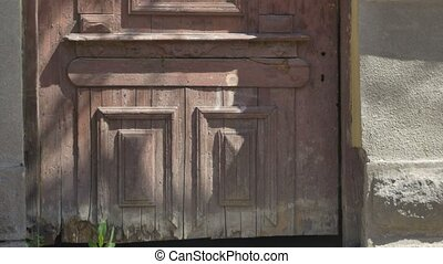 Grunge Door of Abandoned House - Tilt shot to a grunge wood...