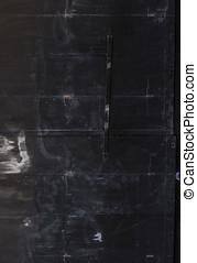 Metallic black door. - Dirty metallic black door.