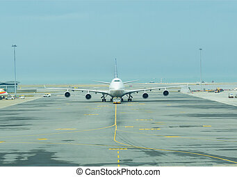 Airplane - An airplane is towing at terminal area in the...