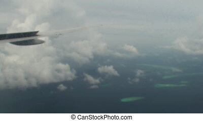 Maldives Islands aerial view from plane window.