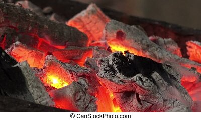 Firewood and hot coal in a grill, fire burning for the meat...