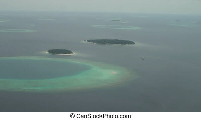 Maldives Islands aerial view from plane window. - Maldives...
