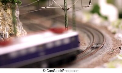 Model train is driving - Model train with wagons is driving,...