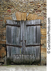 Old derelict wooden door - An old derelict wooden door set...